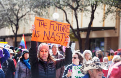 The Future is Nasty Sign held by woman at March Royalty Free Stock Images