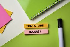The Future is Ours! text on top view office desk table of Business workplace and business objects stock photos
