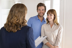 Future owners couple visiting house with realtor agent Royalty Free Stock Image