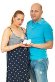Future parents holding baby bootees Royalty Free Stock Image
