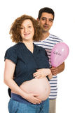 Future parents holding pink balloon Stock Image