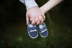 Future parents holding their hands royalty free stock image