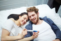 Future parents. Married couple looking at positive pregnancy-test Royalty Free Stock Image