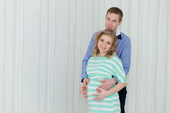 Future parents posing at home Stock Image
