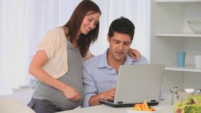 Future parents using a laptop Stock Photography