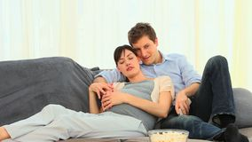 Future parents watching a movie Stock Photography