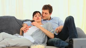 Future parents watching tv Stock Photo