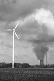 Future and past. Renewable energy by a wind wheel and an old CO ² - producing, pollutive coal-fired power station, in Dortmund, Germany stock images