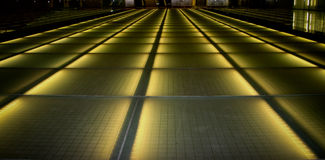Future path. The lighted walkway looks like a runway in this airport view Royalty Free Stock Photos