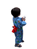 Future photographer. A little boy wearing Japanese traditional clothes and handing a digital camera Stock Photo