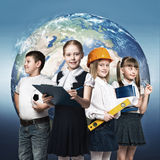 Future profession. Children of school age trying different professions. Elements of this image are furnished by NASA Royalty Free Stock Images