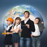 Future profession. Children of school age trying different professions. Elements of this image are furnished by NASA Royalty Free Stock Photo