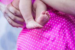 Future profession. choice from a small. Age. children& x27;s legs. little baby girl and her mom Royalty Free Stock Photos