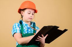 Future profession. Kid builder girl. Build your future yourself. Initiative child girl hard hat builder worker. Child. Care development. Safety expert. Foreman royalty free stock image