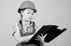 Future profession. Kid builder girl. Build your future yourself. Initiative child girl hard hat builder worker. Child. Care development. Safety expert. Foreman stock photos