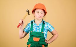 Future profession. Kid builder girl. Build your future yourself. Initiative child girl hard hat helmet builder worker. Tools to improve yourself. Child care stock photo
