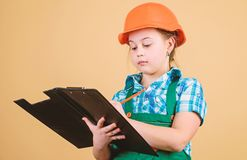 Future profession. Kid builder girl. Build your future yourself. Initiative child girl hard hat builder worker. Child. Care development. Safety expert. Foreman royalty free stock photo