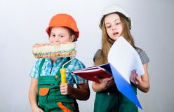 Future profession. Kids girls planning renovation. Children sisters run renovation their room. Amateur renovation. Sisters renovating home. Dreaming about new royalty free stock photos
