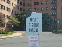 Future resident parking sign. In front of brick building Royalty Free Stock Image