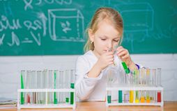 Future scientist. Explore and investigate. School lesson. Interesting approach to learn. Girl cute school pupil play. Explore and investigate. School lesson stock images