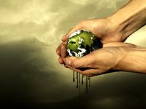Future Shock. Hands holding a wounded earth Stock Photo