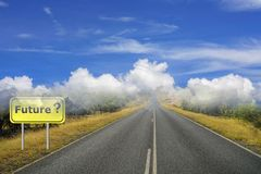 Future sign with a question mark. A future sign and road going into the horizon with clouds depicting uncertain future stock image