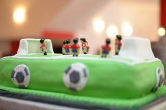 Future soccer  player. Baby boy birthday cake stadium like Stock Image