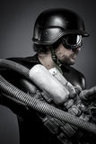 Future.Starfighter with huge plasma rifle, fantasy concept, military helmet and goggles motorcyclist. Space.Starfighter with huge plasma rifle, fantasy concept stock photo