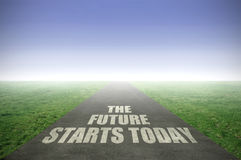 The future starts today. Painted on an open road leading out to the horizon royalty free stock photos
