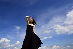 Future success. Girl on blue sky. Woman with fashion look. Beauty and fashion style. Joyful cute girl outdoor. Free and royalty free stock photography