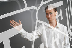 Future technology, navigation, location concept. Man showing transparent screen with gps navigator map. Stock Photography