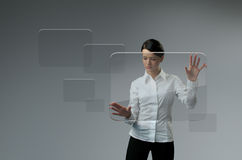 Future technology. Girl press button touchscreen interface. Future technology touchscreen interface Stock Image