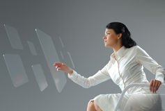 Future technology. Girl press button touchscreen interface. Stock Photo