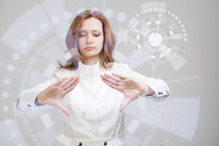 Future technology. Woman working with futuristic. Future technology. Touch button interface. Woman working with futuristic interface Royalty Free Stock Photo