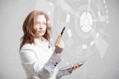 Future technology. Woman working with futuristic. Future technology. Touch button interface. Woman working with futuristic interface Royalty Free Stock Photography
