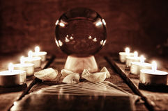 Future teller candle divination. Crystal ball for predicting the fate and supernatural action on the table from the old mahogany with candles and cards stock photos