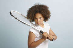 Future tennis star. Mixed race young girl with a tennis racket Royalty Free Stock Images