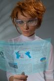 Future times. Future newspaper on transparent screen  - beautiful woman holding transparent futuristic monitor (shoot with professional makeup and hair stylist Stock Images