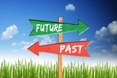 Future versus past two different way with signpost arrows. With blue sky as background Stock Photography
