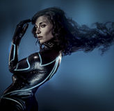 Future women concept, black latex with neon lights Stock Photo