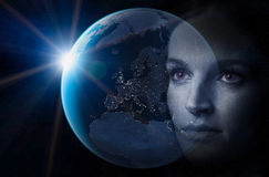 Future world. Women looking in to the earth at night Royalty Free Stock Photos