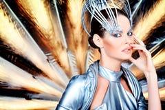 Futurism. Fashion shot of a beautiful young woman in futuristic costume stock photos