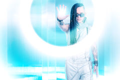 Futurism. Portrait of the eccentric futuristic man in silver costume. Innovations and high technology. Rock artist stock photos