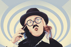 Vintage futurist using phone on time warp backdrop Stock Photos