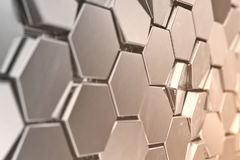 Futuristic abstract hexagonal background with depth of field effect. Structure of a large number of hexagons. Steel. Honeycomb wall texture, shiny hexagon Stock Image