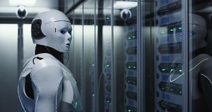 Futuristic android robot working in server room stock photos
