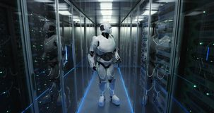 Futuristic android robot working in server room stock footage