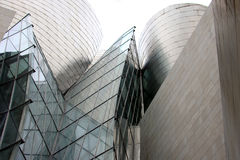 Futuristic architecture in Bilbao (Spain). Part of the Guggenheim Museum Bilbao, designed by North American architect Frank O. Gehry. This building is an example Royalty Free Stock Photo
