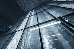 Futuristic architecture with large glass surface Stock Images