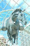 Futuristic architecture. LEEDS, UK - APRIL 17, 2015: Close up of modern equestrian sculpture entitled Equus Altus by Andy Scott inside Trinity shopping centre in Royalty Free Stock Photos